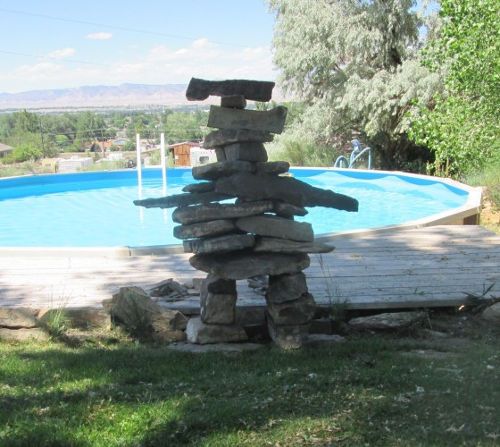 rebuild of the pool inukshuk -- Betty mandated a relocation as she thought the original version blocked some plants from watering